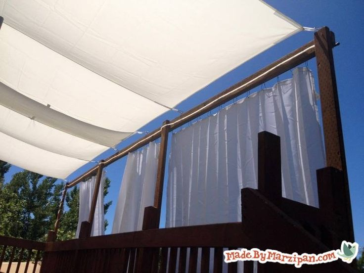 Check out my DIY Deck Awning! Create a shady, breezy summertime hangout with a DIY deck awning.