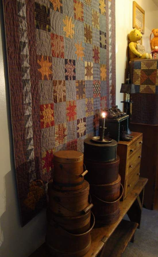 Love everything in this pic. Quilt colors, firkins, drawers, lamp, bench... So primitive