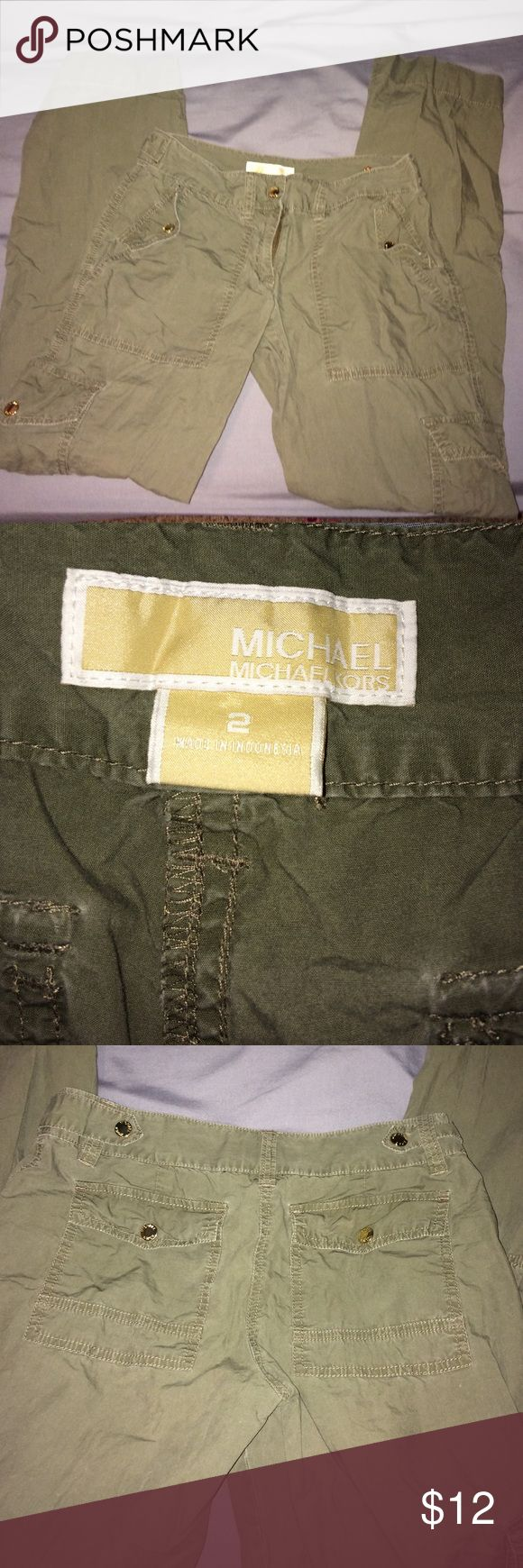 Michael Kors Cargo Pants Lightly worn cargo pants with gold details. Super cute and can be worn long or rolled up. Looks great with flats or wedges and a black tshirt. MICHAEL Michael Kors Pants