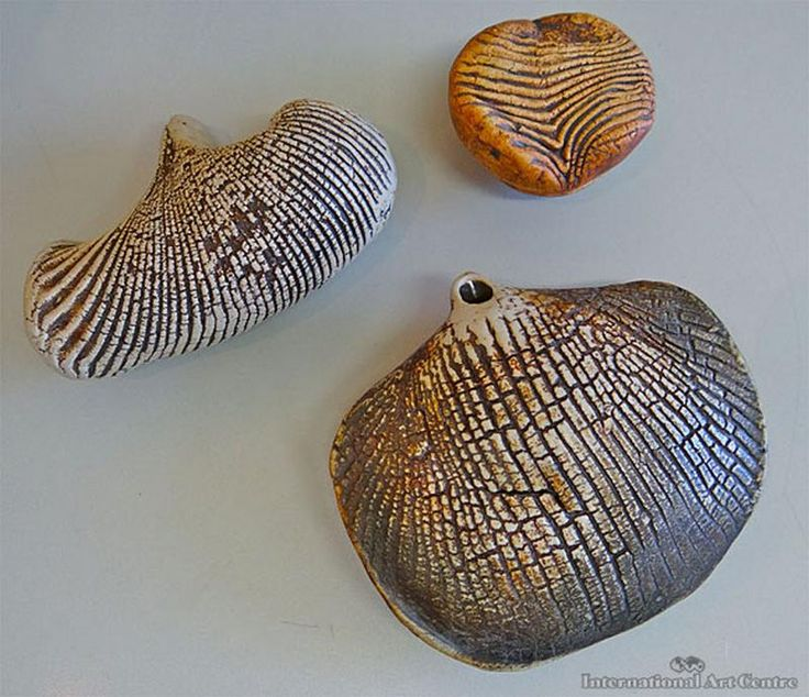 Hanging Vessel, a Sculptural Fossil Style Vessel and a Small Pot with Cover, (3)