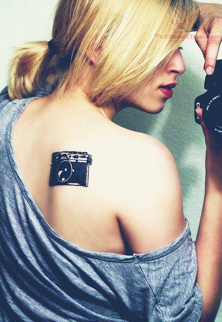 Black Camera Tattoo On Back