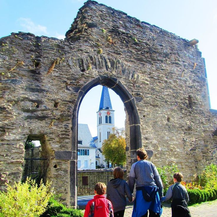 Walking toward St. Severus' church through a Roman arch in #boppard #germany.  Peeling the layers of history with #familytravel