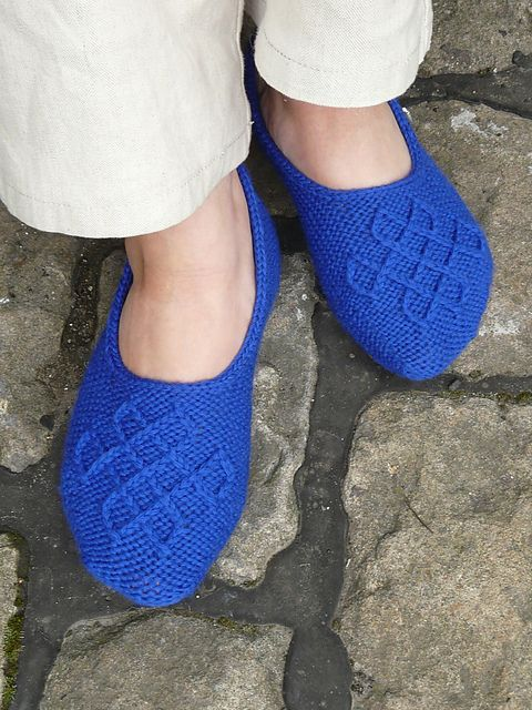From Ravelry: Cair Paravel pattern by Ann Kingstone. They look like slippers fit for royalty to us!