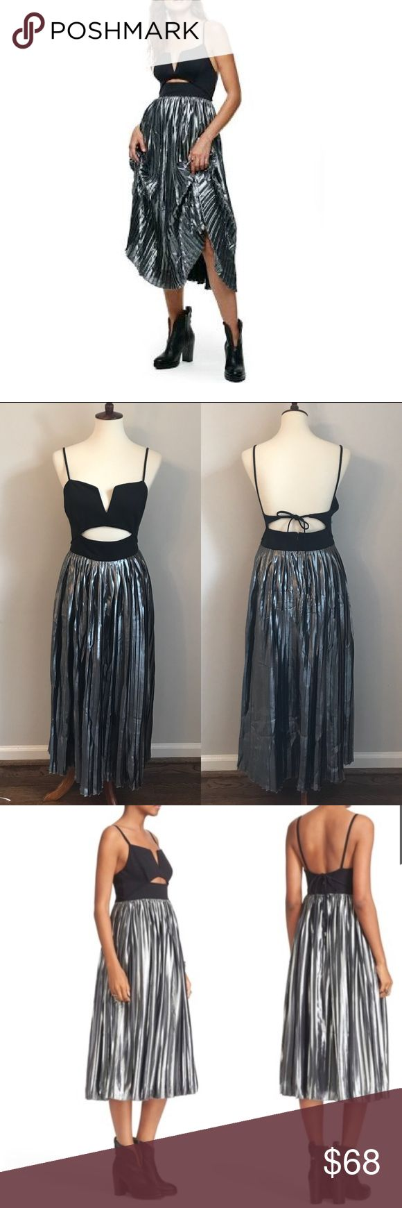 """🌟LOWEST🌟NWT Free People Black/Silver Dress NWT Free People Piper pleated black and silver midi dress. Shimmery, glamorous party dress with a cutout bodice, split neck, and accordion pleated skirt. Sleeveless and hidden back-zip with tie closure. 63% nylon, 33% cotton, 4% spandex.  Measurements (flat): armpit to armpit: 18.5""""; waist (where top and skirt meet): 16""""; length (armpit to hem): 38""""  In excellent new condition. From a smoke and pet free home. Free People Dresses Midi"""