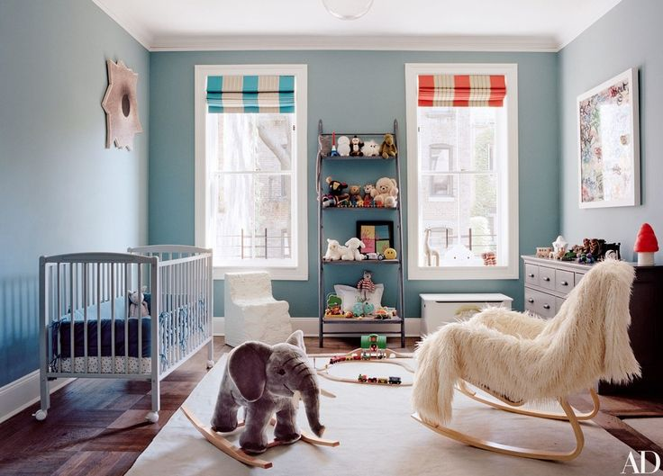 In Laure Heriard Dubreuil and Aaron Young's New York rowhouse, the walls in son Marcel's room are painted in a Donald Kaufman blue (DKC-104), the dresser is by RH Baby & Child, the chair near the window is by Max Lamb, and the Roman shades are of a striped Boussac fabric in different colorways.