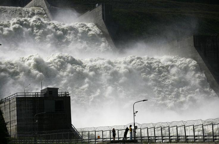 Visitors look at a spillway at the Sayano-Shushenskaya hydro electric power station. (Reuters/Ilya Naymushin)