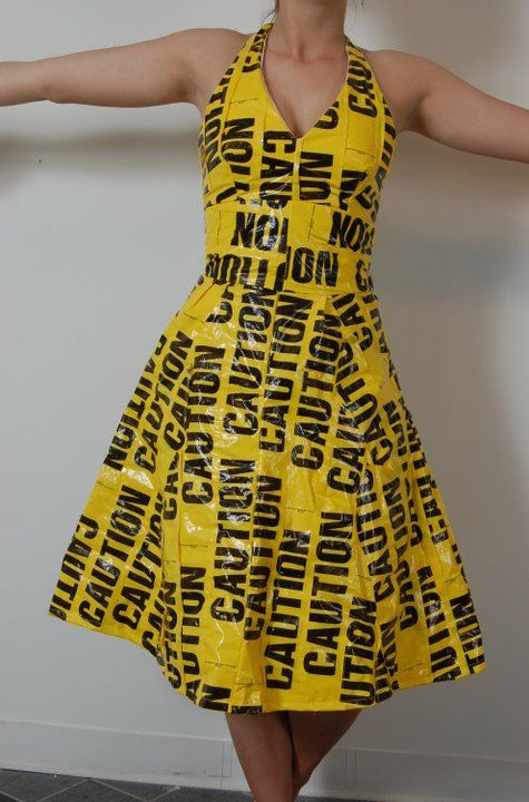 Fantastic Halloween costume. A combination of caution strips with leopard print duct (Duck) tape??