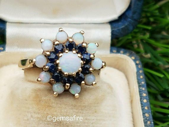 Check out this item in my Etsy shop https://www.etsy.com/uk/listing/578456266/superb-opal-and-sapphire-double-halo