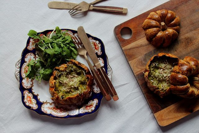 oven roasted bumpkins stuffed with cavolo nero, garlic and parmesan then topped with pine nuts