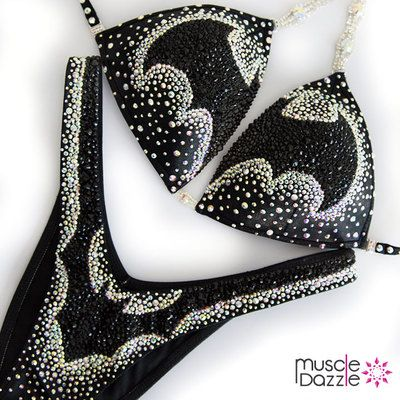 You're already a superhero... you just need the bikini! This Batman inspired figure suit features black and clear crystals on black fabric.  And don't forget to check out our full range of figure suits & competition bikinis at >> www.muscledazzle.com
