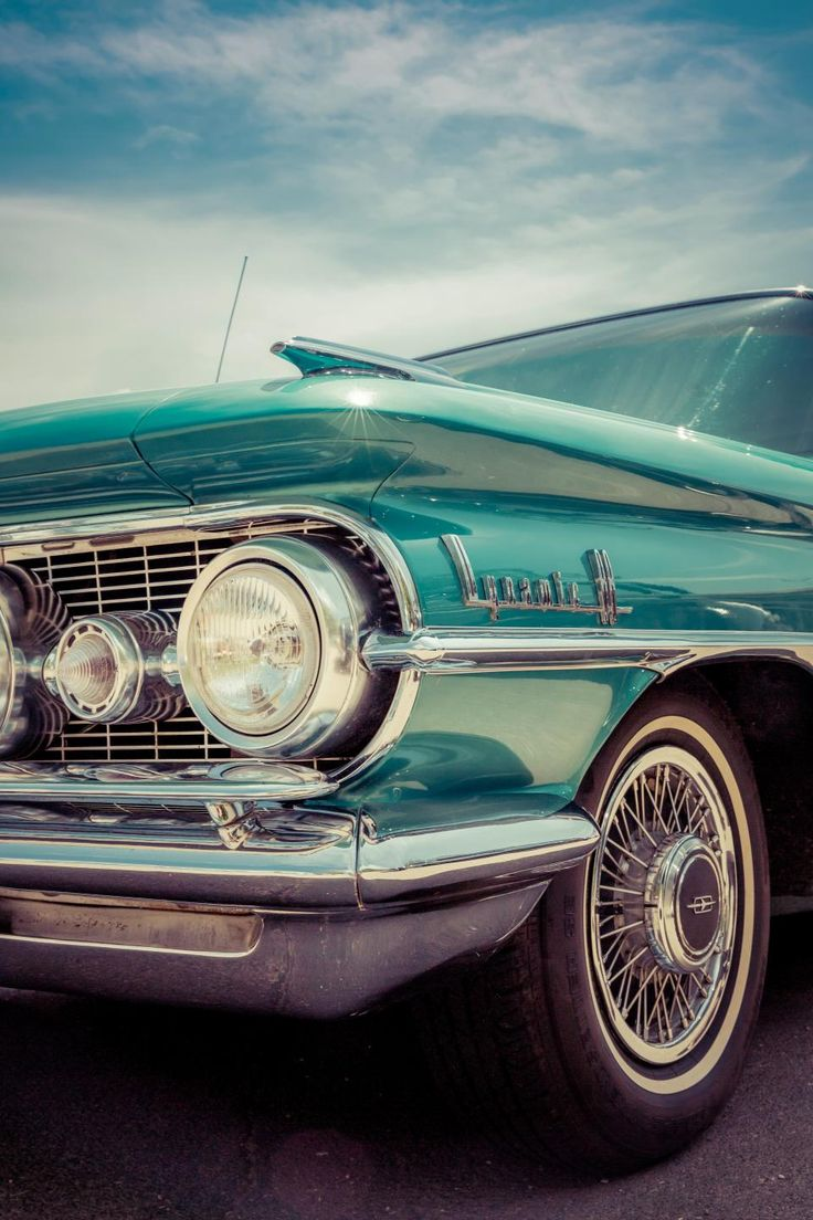 vehicle head light bumper vintage wheel windshield travel transportation road sky clouds car green sunlight