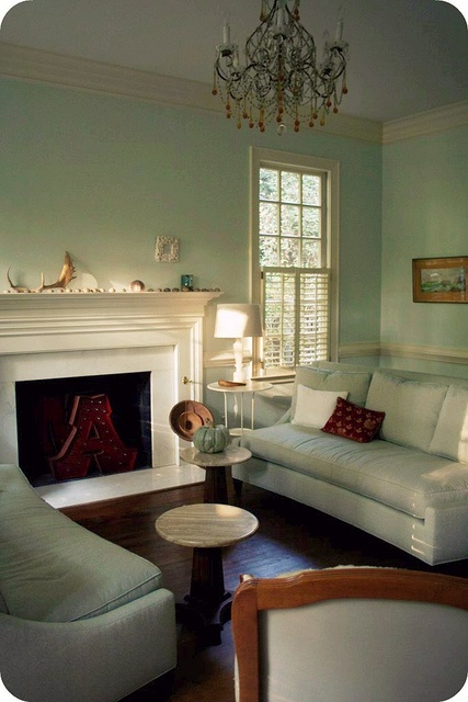 Palladian Blue Walls White Fireplace And Hardwood Floors
