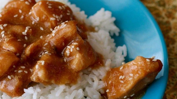 This easy recipe makes chicken in a sauce made with soy sauce, honey, and ketchup, and topped with sesame seeds, all in a slow cooker.