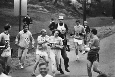 "In 1967, Kathrine Switzer was the first woman to run the Boston marathon. After realizing that a woman was running, race organizer Jock Semple went after Switzer shouting, ""Get the hell out of my race and give me those numbers."" However, Switzer's boyfriend and other male runners provided a protective shield during the entire marathon. The photographs taken of the incident made world headlines, and Kathrine later won the NYC marathon with a time of 3:07:29."