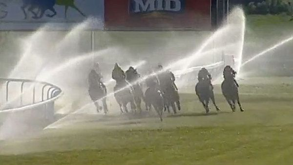 Malfunctioning sprinklers down the stretch surprises horses at Bathurst Racecourse in Australia. Fortunately, no horses or jockeys were hurt.