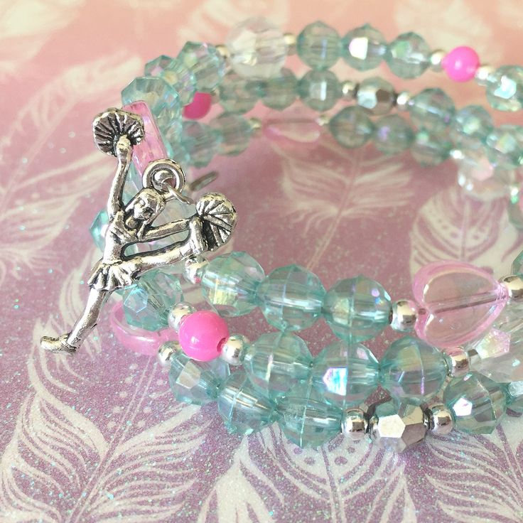 Jewelry Making Birthday party kits by Beading Buds.  Blue and pink bracelet with cheerleading charm.