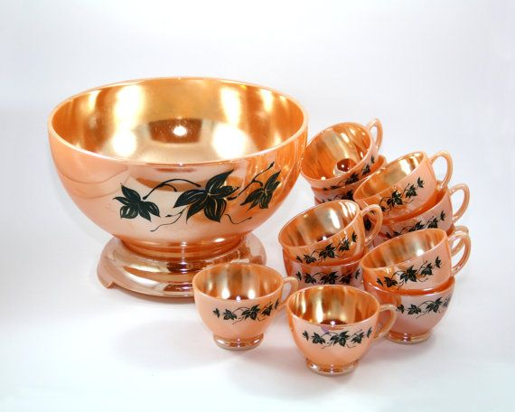 Vintage Fire King peach luster punch bowl set, circa 1950s. This stunning punch bowl is known as Laurel Plain or Laurel Leaf. It has a green ivy