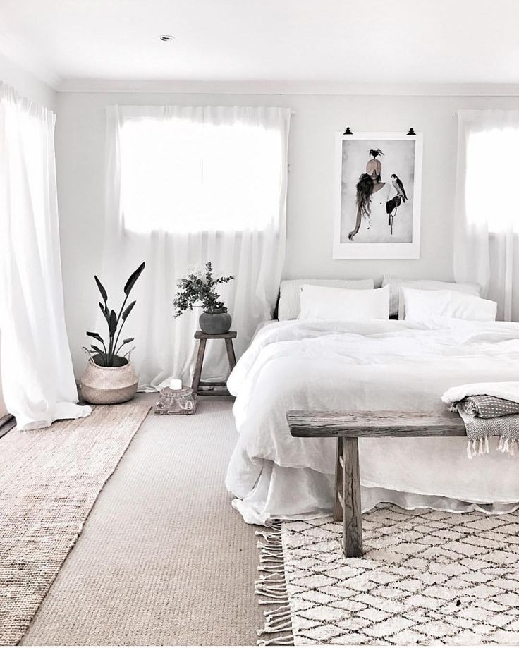 Monochrome white bedroom with art print above bed bware for Small rug for bedroom