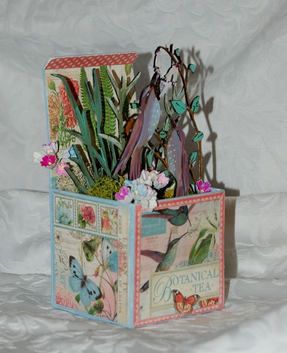 Bursting with life, this altered ATB by Zuzu uses Calico Craft Parts