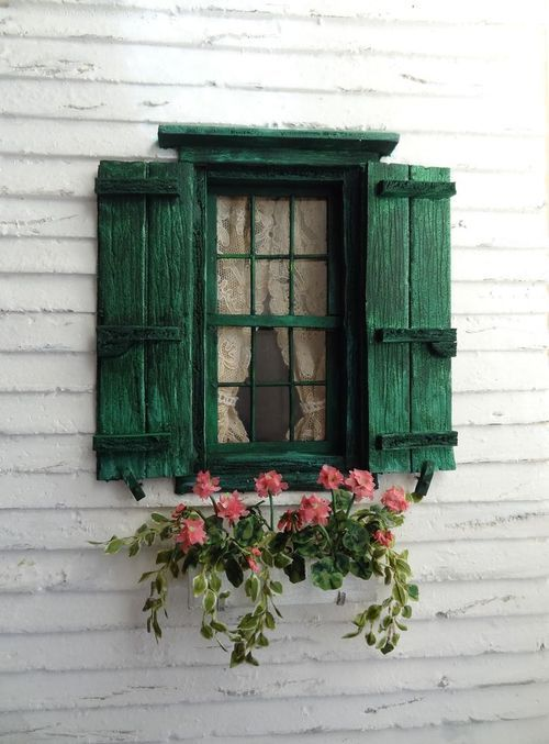 Green wood board and battens with a flower box. Copy this look at www.timberlane.com
