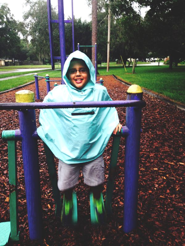 Playing at the park in Roo Rain Gear rain wear made from RPET