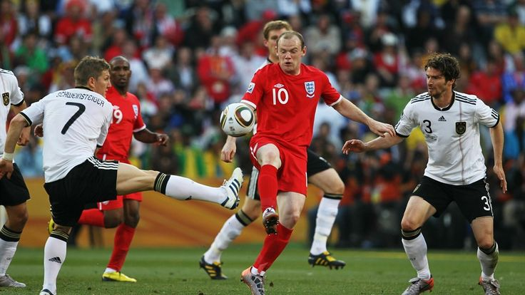Wayne Rooney of England (C) controls the ball under pressure from Bastian Schweinsteiger (L) and Arne Friedrich of Germany (R) during the 2010 FIFA World Cup South Africa Round of Sixteen match between Germany and England at Free State Stadium on June 27, 2010 in Bloemfontein, South Africa.