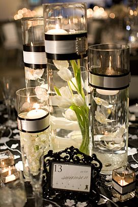 I LOVE these centerpieces.. Could be done easily but so elegant looking! I really like the buckle!!