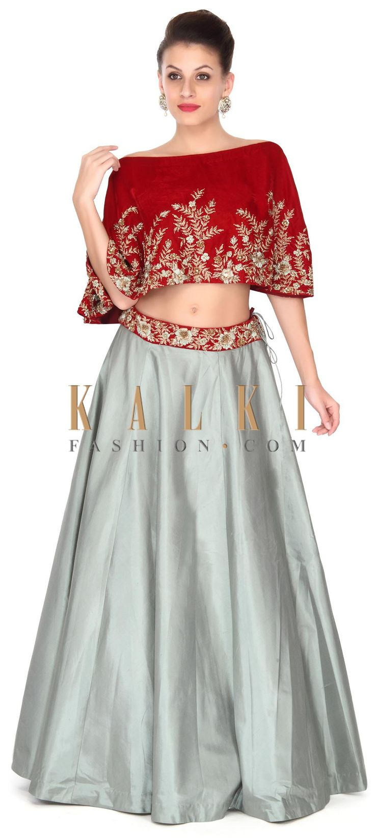 Buy this Grey lehenga matched with maroon velvet cape only on Kalki