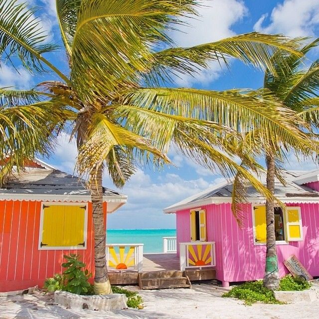 Bright vibrant colors on a pair of cottage homes from for Bright vibrant colors