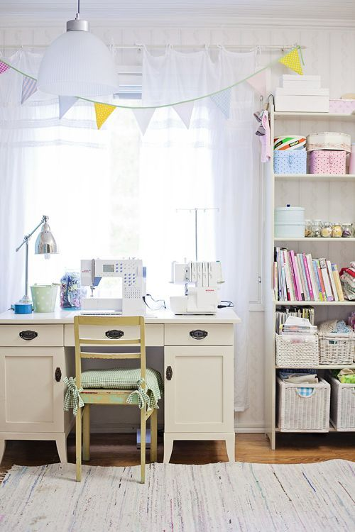 .Little handmade touches like colorful bunting and a seat cushion make this little sewing nook bright and cheery!