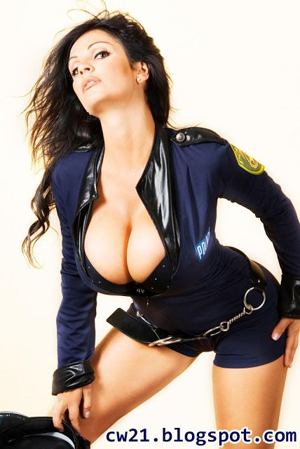 Share: Denise Milani Busty Cop 2