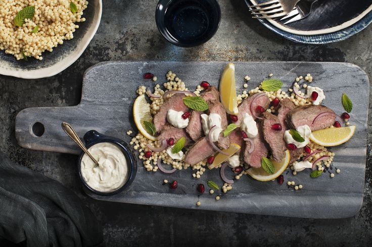 Minted Lamb with Fetta & Yoghurt. Barbecued lamb back strap served sliced drizzled with a spiced Fetta, pomegranate seeds and yoghurt sauce. #Lemnos #lamb #mint #fetta #yummy