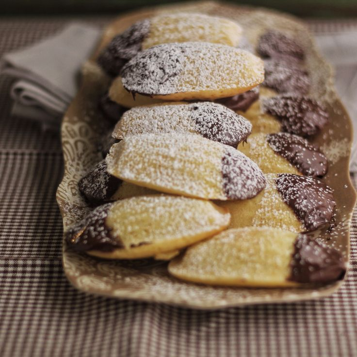 Madelines are a French butter cake baked in shell shaped molds. Add a little orange zest, dip them in chocolate and voila!