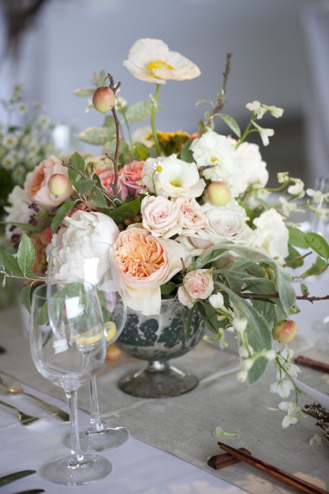 Lush white and pink centerpiece with flowers branches