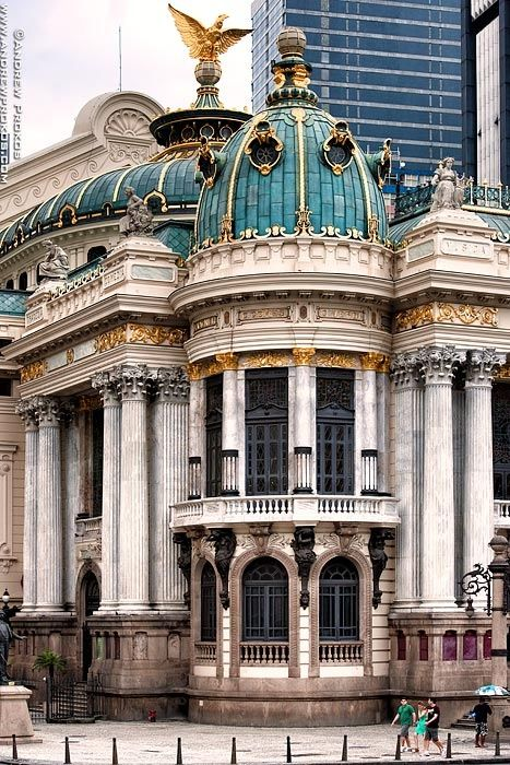 Theatro Municipal, Rio de Janeiro, Brazil is designed in an eclectic style, inspired by the Paris Opéra of Charles Garnier. It is located near the National Library and the National Fine Arts Museum, overlooking the spacious Cinelândia Square. Built in the beginning of the 20th century, it is considered to be one of the most beautiful and important theatres in the country. by andrew prokos