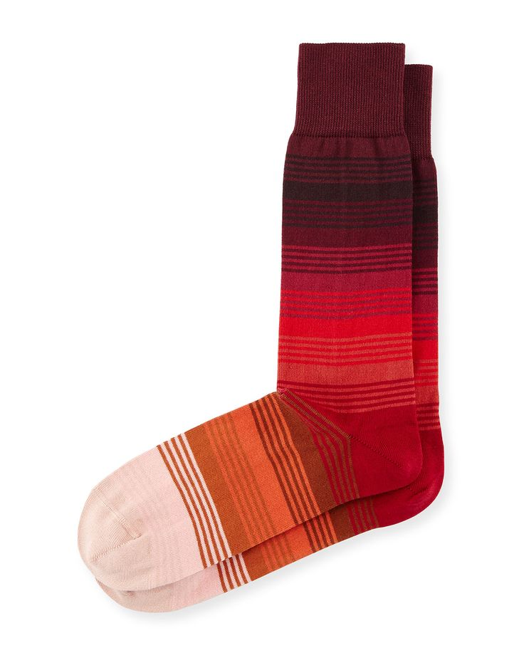 Paul Smith socks in gradient stripes. Ribbed cuff prevents sock from slipping…