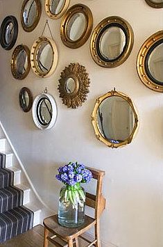 a collection of mirrorsWall Art, Round Mirrors, Mirrors Wall, Brabourne Farms, Bullseye Mirrors, Gold Mirrors, Mirrors Collection, Gold Things, Mirrors Mirrors