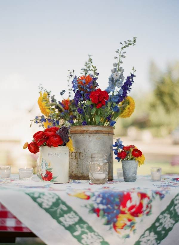 Vintage tablecloth and bright, colorful centerpiece