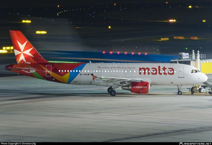 9H-AEQ Air Malta Airbus A320-214 9H-AEQ aircraft, with the stcker ''The airline of the Maltese Islands'' on the airframe, skating at Austria Vienna Schwechat International Airport. November 2016.