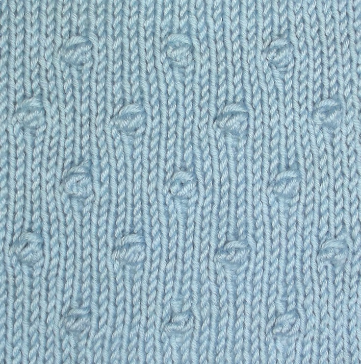 Spaced Knots is an easy, allover textured patten that will add interest to plain stocknette stitch.
