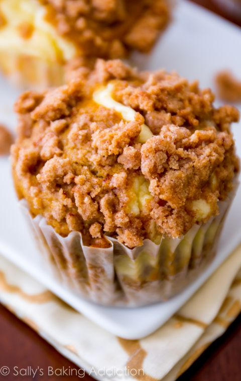These Pumpkin Cheesecake Muffins are incredible! Cinnamon-spiced and topped with tons of streusel. Recipe by sallysbakingaddiction.com