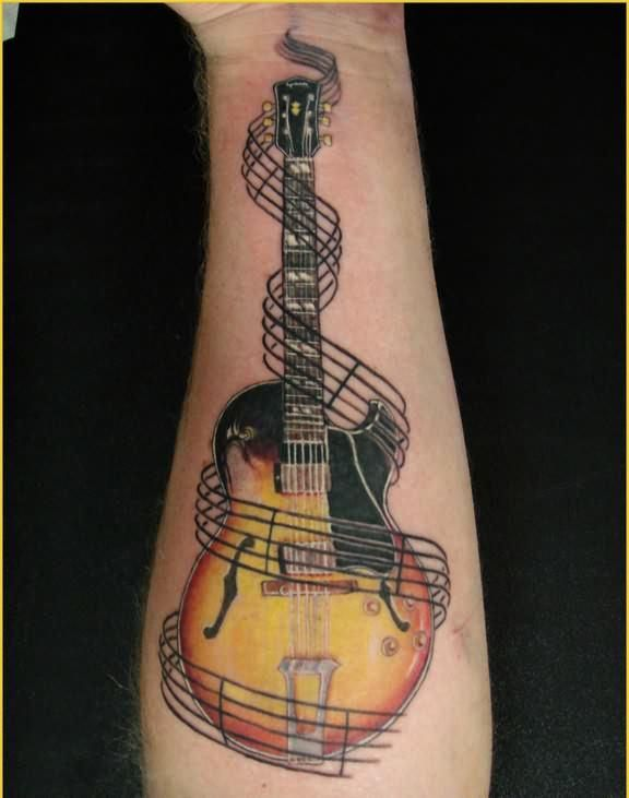 A high quality music tattoo of a guitar surrounded by musical staves