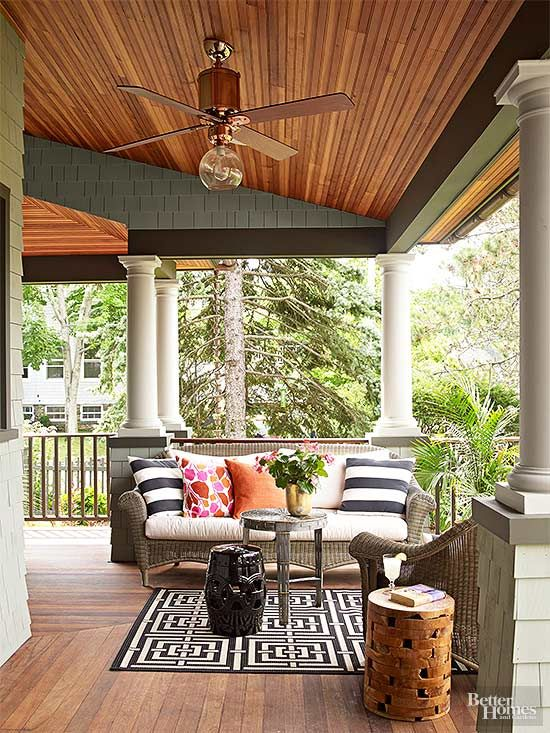 Generous dimensions make the new wraparound porch an ideal spot for outdoor entertaining. Painted columns lend stately character, and the stained…