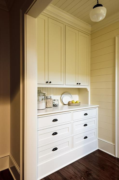 Cottage Pantry Designed With Ivory Cabinets And Beadboard Backsplash  Accented With Oil Rubbed Bronze Cup Pulls