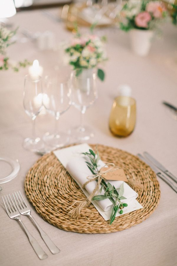 Sweet rustic garden table styling; rattan placemats, neutral linens and olive branch springs.