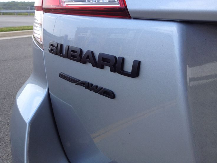 2012 Subaru Outback with plastidipped badges.