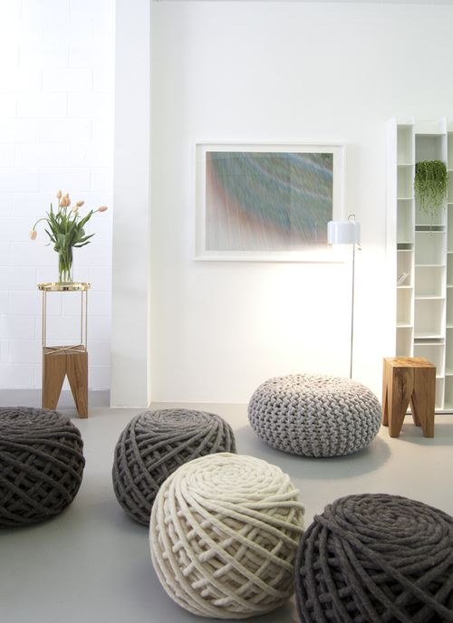 In The Foreground Are Meindertsmau0027s Texelaar Ottoman Poufs. The Wooden  Backenzahn Stools Are By Phillip Mainzer For And ...