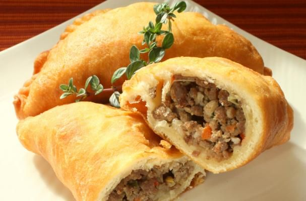 Irish Comfort: Handheld Meat #Pies. Handheld meat pies are a comforting Irish dish.  Ground beef and pork are flavored with garlic, green onion, and red bell pepper.  The filling is tucked into a homemade dough and deep fried.  If you are short on time, you can make this recipe with pre-made pie dough and bake the pies instead of fry them. - Foodista.com