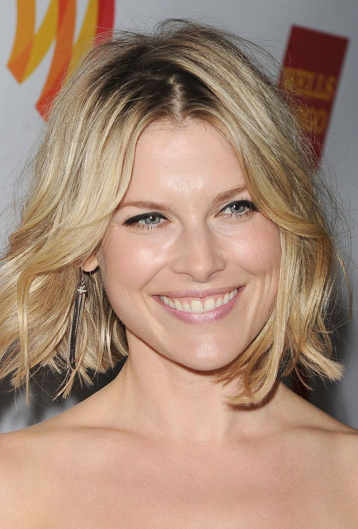 The woman with this haircut actually has straight hair cut into a classic, angled bob, which is a great cut for women with long faces. What I love about this style is she curled her hair, which adds width to an otherwise thin face.