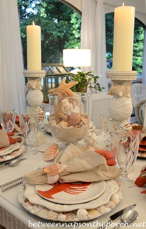 What a soft, romantic beach tablescape!  Crab and lobster plates, seashells, and soft colors except for an occasional punch of strong terra cotta.  Yum.